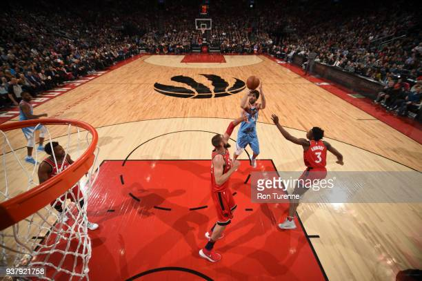 Milos Teodosic of the LA Clippers shoots the ball against the Toronto Raptors on March 25 2018 at the Air Canada Centre in Toronto Ontario Canada...