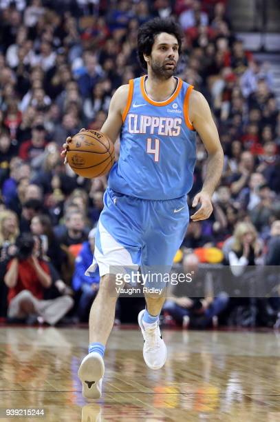 Milos Teodosic of the Los Angeles Clippers dribbles the ball the first half of an NBA game against the Toronto Raptors at Air Canada Centre on March...