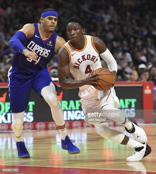 Milos Teodosic of the Los Angeles Clippers drives past Tobias Harris of the Los Angeles Clippers in the second half at Staples Center on April 1 2018...
