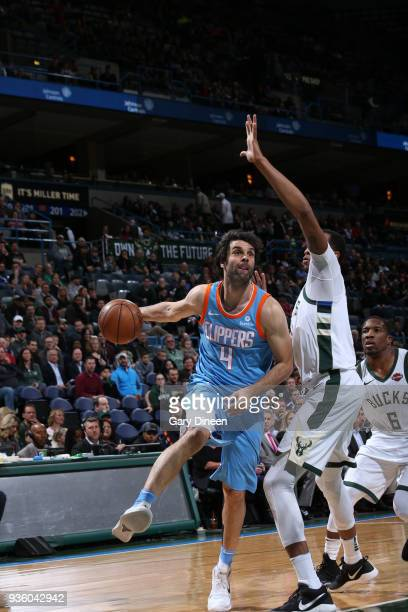 Milos Teodosic of the Los Angeles Clippers drives to the basket against John Henson of the Milwaukee Bucks during the NBA game on March 21 2018 at...