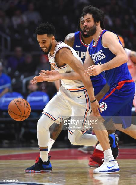 Milos Teodosic of the Los Angeles Clippers guards Courtney Lee of the New York Knicks in the first half at Staples Center on March 2 2018 in Los...