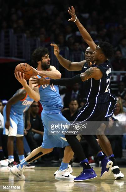 Milos Teodosic of the Los Angeles Clippers looks to make a pass play against Wesley Iwundu of the Orlando Magic during the second half of the NBA...
