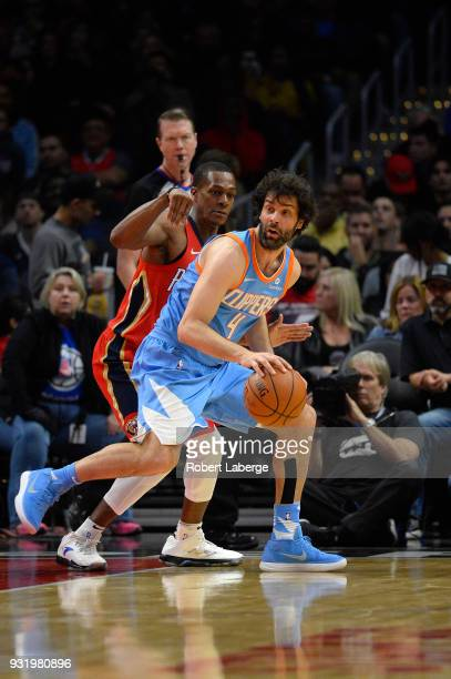 Milos Teodosic of the Los Angeles Clippers plays against Rajon Rondo of the New Orleans Pelicans at STAPLES Center on March 6 2018 in Los Angeles...