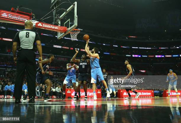 Milos Teodosic of the Los Angeles Clippers shoots a short jump shot over Khem Birch of the Orlando Magic during the NBA game between the Orlando...