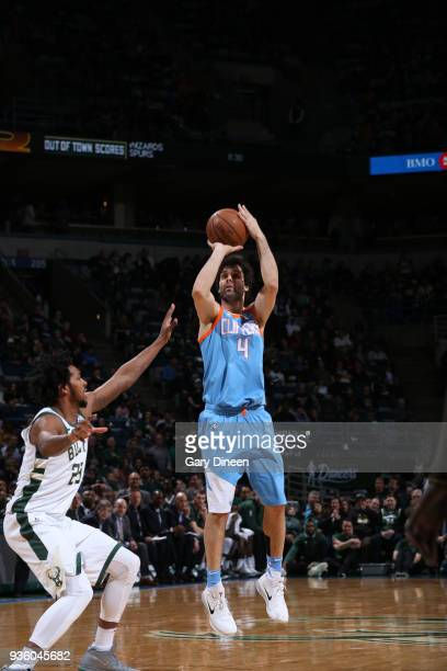 Milos Teodosic of the Los Angeles Clippers shoots against Sterling Brown of the Milwaukee Bucks during the NBA game on March 21 2018 at the BMO...
