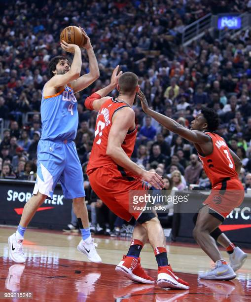 Milos Teodosic of the Los Angeles Clippers shoots the ball the first half of an NBA game against the Toronto Raptors at Air Canada Centre on March 25...