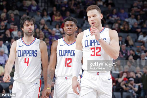 Milos Teodosic Tyrone Wallace and Blake Griffin of the Los Angeles Clippers look on during the game against the Sacramento Kings on January 11 2018...