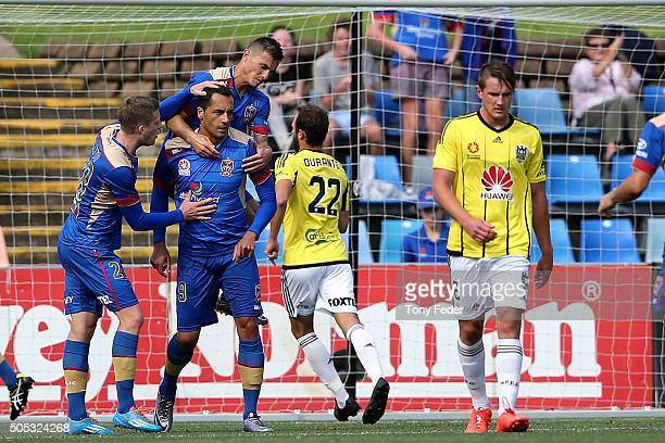 Milos Trifunovic of the Jets celebrates a goal with team mates during the round 15 ALeague match between the Newcastle Jets and the Wellington...