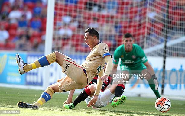 Milos Trifunovic of the Jets contests the ball with Scott Jamieson of the Wanderers during the round 23 ALeague match between the Newcastle Jets and...