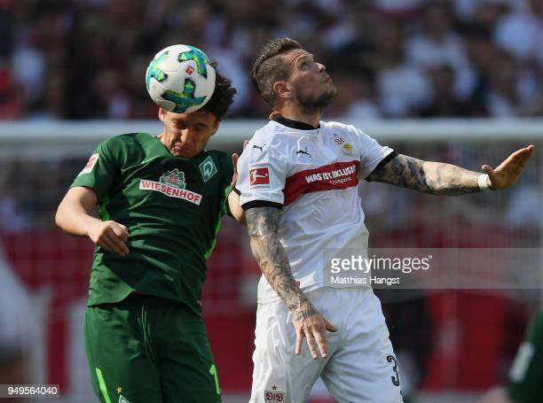 Milos Veljkovic of Bremen jumps for a header with Daniel Ginczek of Stuttgart during the Bundesliga match between VfB Stuttgart and SV Werder Bremen...