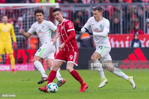Milos Veljkovic of Bremen Robert Lewandowski of Muenchen and Maximilian Eggestein of Bremen battle for the ball during the Bundesliga match between...