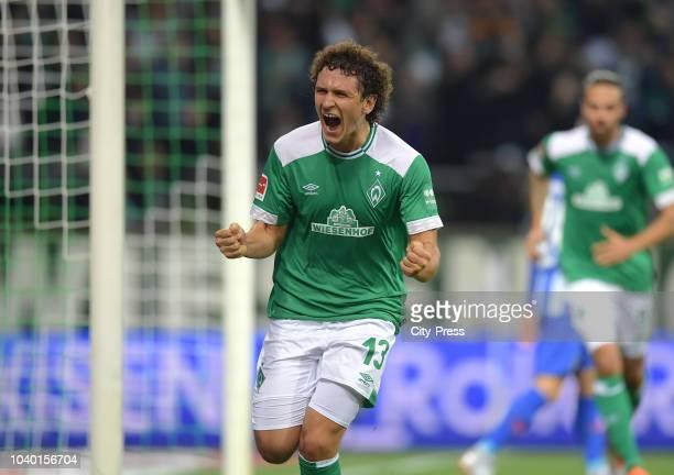 Milos Veljkovic of Werder Bremen celebrates after scoring the 2:0 during the Bundesliga match between SV Werder Bremen and Hertha BSC at Weserstadion...