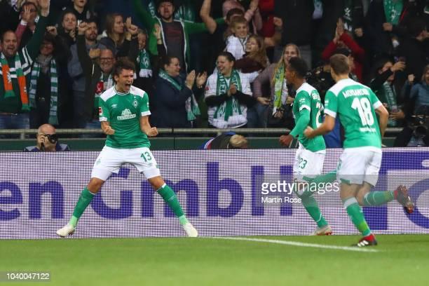 Milos Veljkovic of Werder Bremen celebrates with team mates after scoring his team's second goal during the Bundesliga match between SV Werder Bremen...