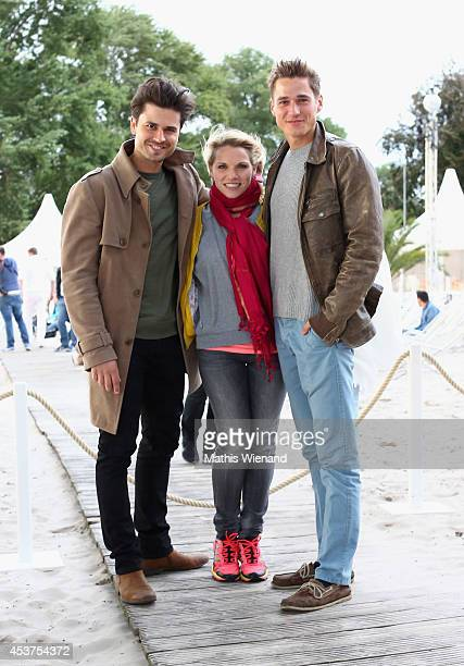 Milos Vukovic Maria Kempken Timothy Boldt attend the Land Rover Public Chill 2014 at km689 on August 17 2014 in Cologne Germany