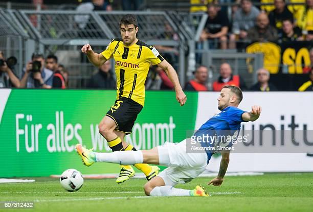 Milosevic Sjoestroem of SV Darmstadt 98 challenges Adrian Ramos of Borussia Dortmund during the Bundesliga match between Borussia Dortmund and SV...