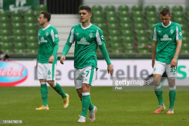 Milot Rashica, Kevin Moehwald and Maximilian Eggestein of Werder Bremen reacts on the full time whistle following the Bundesliga match between SV...