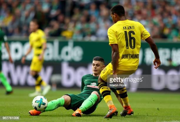 Milot Rashica of Bremen and Manuel Akanji of Dortmund battle for the ball during the Bundesliga match between SV Werder Bremen and Borussia Dortmund...