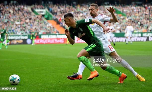 Milot Rashica of Bremen and Stefan Ilsanker of Leipzig battle for the ball during the Bundesliga match between SV Werder Bremen and RB Leipzig at...