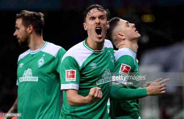Milot Rashica of Bremen celebrate with team mate Max Kruse after he scores the 3rd goal during the Bundesliga match between SV Werder Bremen and FC...
