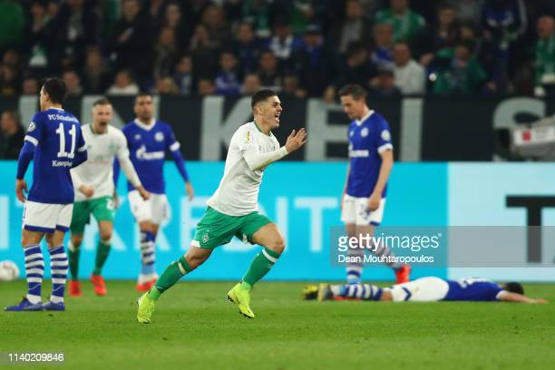 Milot Rashica of Bremen celebrates his team's first goal during the DFB Cup quarterfinal match between FC Schalke 04 and Werder Bremen at...