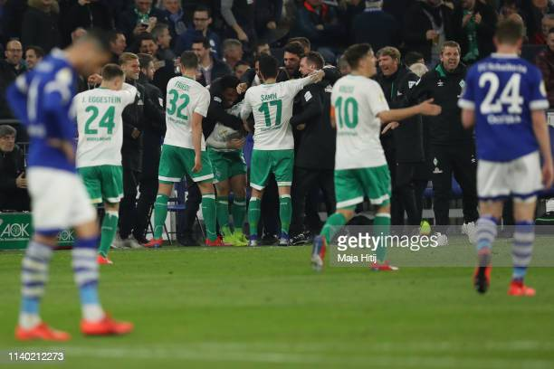 Milot Rashica of Bremen celebrates his team's first goal with team mates during the DFB Cup quarterfinal match between FC Schalke 04 and Werder...
