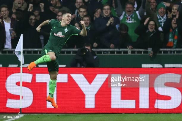 Milot Rashica of Bremen celebrates his team's second goal during the Bundesliga match between SV Werder Bremen and 1 FC Koeln at Weserstadion on...