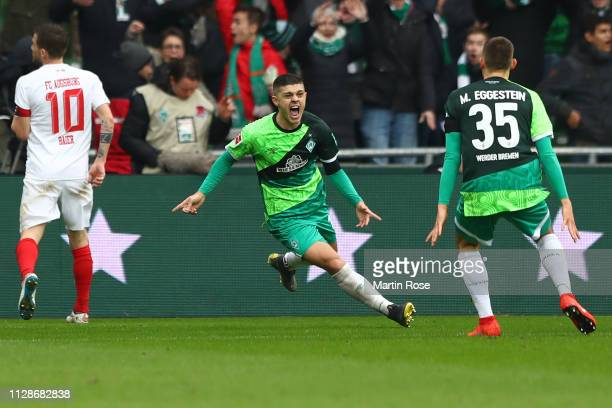 Milot Rashica of Bremen celebrates scoring the 3rd team goal during the Bundesliga match between SV Werder Bremen and FC Augsburg at Weserstadion on...
