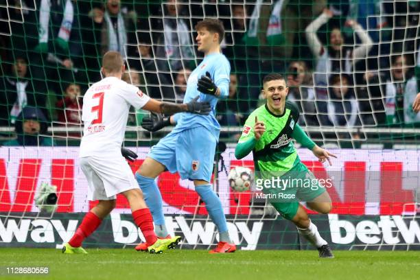 Milot Rashica of Bremen celebrates scoring the opening goal during the Bundesliga match between SV Werder Bremen and FC Augsburg at Weserstadion on...