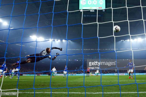 Milot Rashica of Bremen scores his team's first goal against goalkeeper Alexander Nuebel of Schalke during the DFB Cup quarterfinal match between FC...