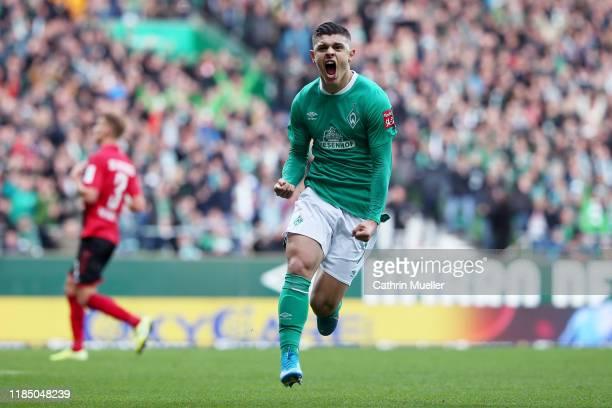 Milot Rashica of SV Werder Bremen celebrates after scoring his team's first goal during the Bundesliga match between SV Werder Bremen and SportClub...