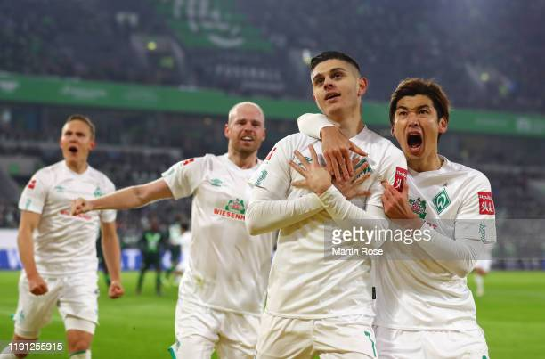 Milot Rashica of SV Werder Bremen celebrates as he scores his team's first goal from a penalty with Yuya Osako during the Bundesliga match between...