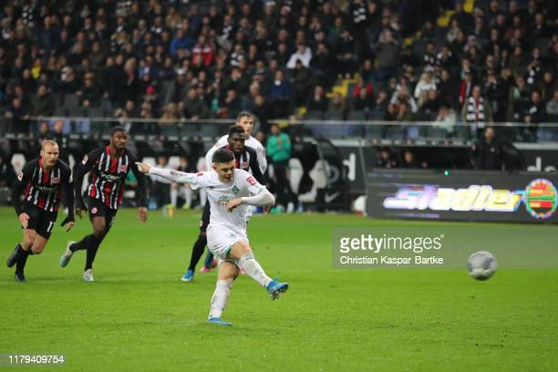Milot Rashica of SV Werder Bremen scores his teams second goal from the penalty spot during the Bundesliga match between Eintracht Frankfurt and SV...