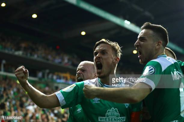 Milot Rashica of Werder Bremen celebrates after scoring his team's second goal during the DFB Cup semi final match between Werder Bremen and FC...