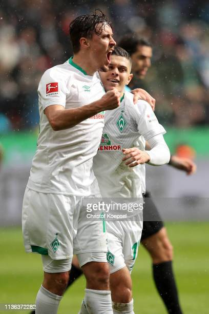 Milot Rashica of Werder Bremen celebrates with Max Kruse of Werder Bremen after he scores his sides second goal during the Bundesliga match between...