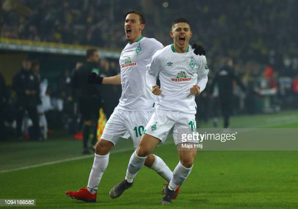 Milot Rashica of Werder Bremen celebrates with teammate Max Kruse after scoring his team's first goal during the DFB Cup match between Borussia...