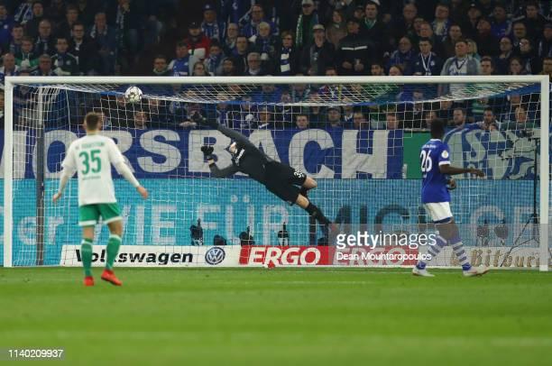Milot Rashica scores his team's first goal past goalkeeper Alexander Nuebel of Schalke during the DFB Cup quarterfinal match between FC Schalke 04...