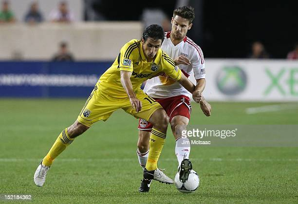 Milovan Mirosevic of the Columbus Crew in action against Heath Pearce of the New York Red Bulls at Red Bull Arena on September 15, 2012 in Harrison,...