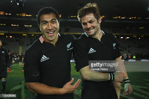Mils Muliaina celebrates with Richie McCaw of the All Blacks after winning the TriNations Bledisloe Cup match between the New Zealand All Blacks and...