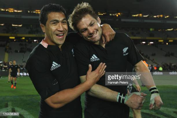 Mils Muliaina celebrates with Richie McCaw of the All Blacks after winning the Tri-Nations Bledisloe Cup match between the New Zealand All Blacks and...