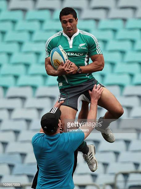 Mils Muliaina is lifted up by John Afoa and Kieran Read during a New Zealand All Blacks training session at ANZ Stadium on September 10 2010 in...