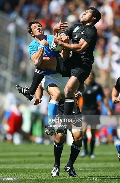 Mils Muliaina of New Zealand tangles with Marko Stanojevic of Italy during Match Two of the Rugby World Cup 2007 between New Zealand and Italy at the...