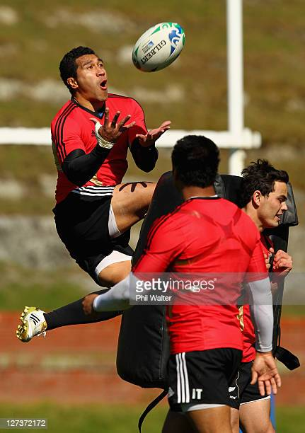 Mils Muliaina of the All Blacks catches the ball during a New Zealand All Blacks IRB Rugby World Cup 2011 training session at Rugby League Park on...