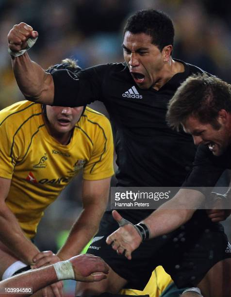Mils Muliaina of the All Blacks celebrates the try of Kieran Read during the 2010 TriNations Bledisloe Cup match between the Australian Wallabies and...