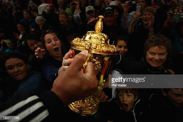 Mils Muliaina of the All Blacks holds out the Webb Ellis Cup for the crowd during the New Zealand All Blacks 2011 IRB Rugby World Cup celebration...