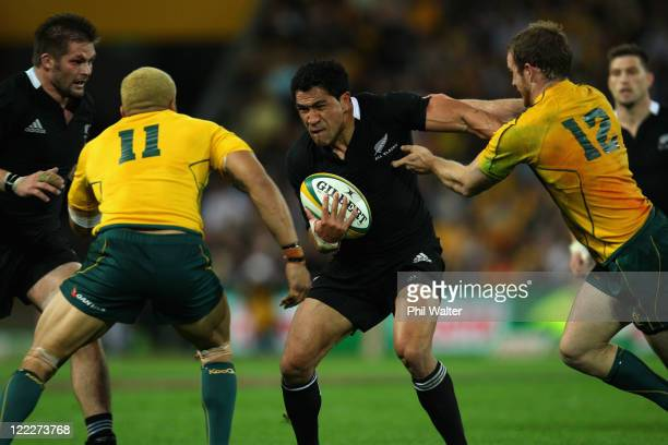 Mils Muliaina of the All Blacks is tackled by Digby Ioane and Pat McCabe during the TriNations Bledisloe Cup match between the Australian Wallabies...