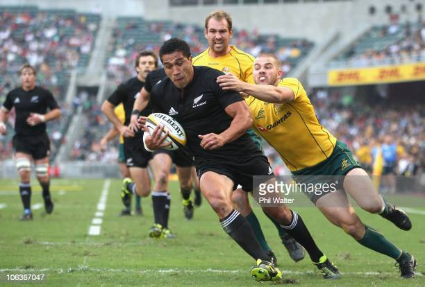 Mils Muliaina of the All Blacks is tackled by Drew Mitchell of the Wallabies during the 2010 TriNations Bledisloe Cup match between the New Zealand...