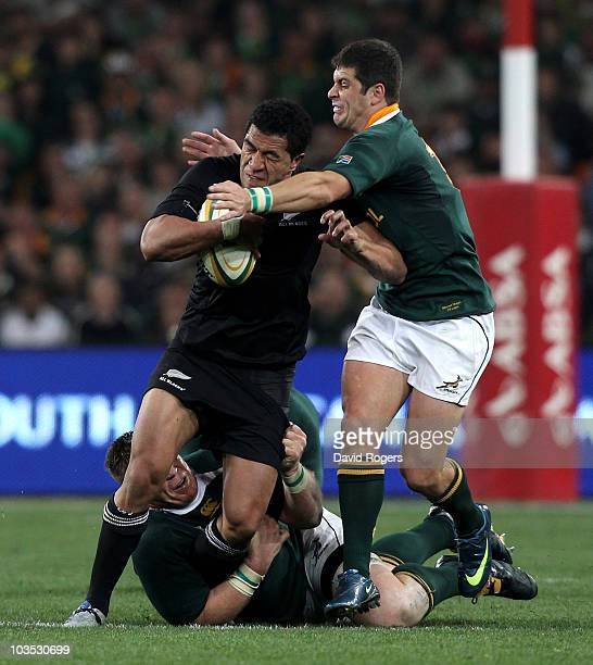 Mils Muliaina of the All Blacks is tackled by John Smit and Morne Steyn during the 2010 TriNations match between the South African Springboks and the...