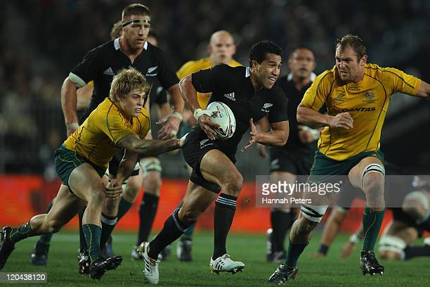 Mils Muliaina of the All Blacks makes a break during the Tri-Nations Bledisloe Cup match between the New Zealand All Blacks and the Australian...