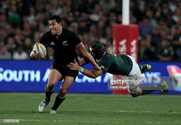 Mils Muliaina of the All Blacks moves away from Victor Matfield during the 2010 TriNations match between the South African Springboks and the New...