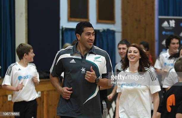Mils Muliaina of the New Zealand All Blacks participates in a game of volleyball as the All Blacks visit Queensferry School as part of the adidas...